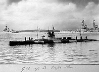 BNPS.co.uk (01202 558833)<br /> Pic Lawrences/BNPS<br /> <br /> British submarine G 13 Scapa Flow<br /> <br /> Fascinating early photos of submarine warfare featuring close quarters views of German battleships have come to light 100 years later.<br /> <br /> The photo albums were collated by British Commander Maurice Bailward who documented every stage of his naval career.<br /> <br /> Cmdr Bailward attended Royal Naval College in Osborne, Isle of Wight, from 1906 and 1908, the same time as Edward, the Prince of Wales.<br /> <br /> He was involved in many of the major sea battles of World War Two as well as the British effort to help the Whites during the Russian Civil War of 1919.<br /> <br /> The albums have emerged for sale at auction from a family descendant with Lawrences Auctioneers, of Crewkerne, Somerset.