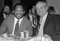 Archie Griffin, left, and former Ohio State coach Woody Hayes share some conversation at dinner Nov. 21, 1983. (Dispatch Photo by Ken Chamberlain)