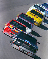 Dale Earnhardt leads a pack of cars through turn 4 at Talladega in May 1991. (Photo by Brian Cleary/www.bcpix.com)