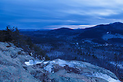 Cloudy sunset from an outlook along the Boulder Loop Trail in Albany, New Hampshire USA, which is part of the White Mountains. Mount Chocorua is off in the distance on the right.