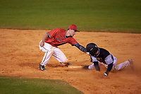 Ball State Cardinals shortstop Alex Maloney (6) tags Billy Quirke (7) sliding into second base during a game against the Wisconsin-Milwaukee Panthers on February 26, 2016 at Chain of Lakes Stadium in Winter Haven, Florida.  Ball State defeated Wisconsin-Milwaukee 11-5.  (Mike Janes/Four Seam Images)