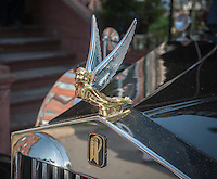 "Hood ornament of a vintage restored 1924 Rolls-Royce hearse owned by Isaiah Owens, of the Owens Funeral Home, in Harlem in New York prior to a procession, on Friday, June 21, 2013, to the Apollo Theater for a showing of Christine Turner's documentary film ""Homegoings"".  The film features Owens and his funeral home as it studies African-American traditions of death. Owens, who moved to New York in the 1960's, opened the funeral home and with just word of mouth and little advertising has become the paramount funeral home in Harlem, due to his care and understanding.  (© Richard B. Levine)"