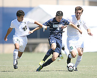 Seth C'deBaca #4 of Georgetown University gets away from Wesley Curtis #22 and Spencer Thompson #8 of Michigan State during an NCAA match at North Kehoe Field, Georgetown University on September 5 2010 in Washington D.C. Georgetown won 4-0.