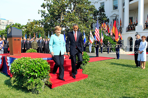 United States President Barack Obama, right, and Angela Merkel, Germany's chancellor, walk off the podium during a welcoming ceremony on the South Lawn of the White House in Washington, D.C., U.S., on Tuesday, June 7, 2011. .Credit: Andrew Harrer / Pool via CNP