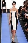 Debora walks runway in a carbon black crepe strapless cocktail dress with ivory jersey draped front panel, by Monique Lhuillier, from the Monique Lhuillier Spring 2012 collection fashion show, during Mercedes-Benz Fashion Week Spring 2012.