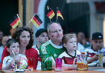 German fans and tourists are seen during the FIFA World Cup 2014 final football match between Germany and Argentine at the pier of Riva del Garda, in Italy on July 13, 2014.