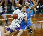 SIOUX FALLS, SD - MARCH 9:  Nate Bruneel #45 from the College of Idaho drives to the basket against Nygel Drury #5 from Dakota Wesleyan during their second round game at the 2018 NAIA DII Men's Basketball Championship at the Sanford Pentagon in Sioux Falls. (Photo by Dick Carlson/Inertia)