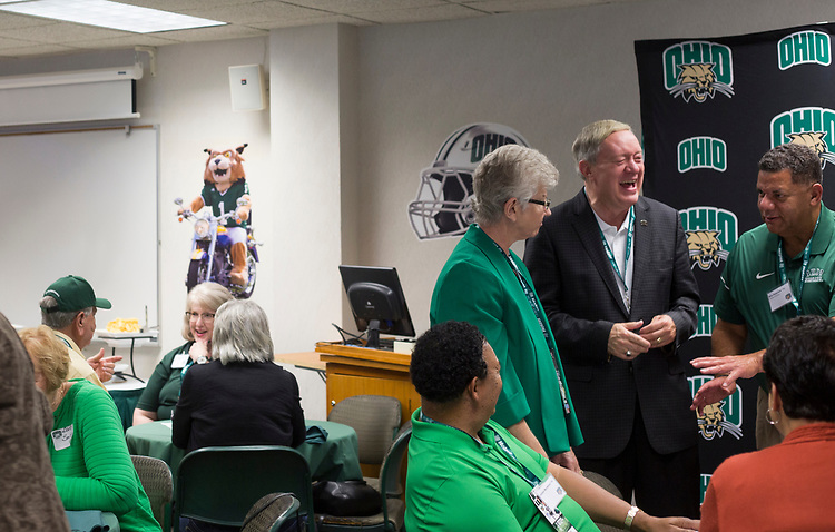 President Duane Nellis and Ruthie Nellis talk to guests in the Presidents box at Peden stadium before the football game against the Hampton Pirates Sept. 2, 2017.
