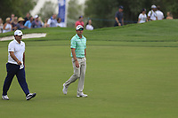 Patrick Reed (USA) an Dean Burmester (RSA) on the 18th fairway during the 3rd round of the DP World Tour Championship, Jumeirah Golf Estates, Dubai, United Arab Emirates. 17/11/2018<br /> Picture: Golffile | Fran Caffrey<br /> <br /> <br /> All photo usage must carry mandatory copyright credit (&copy; Golffile | Fran Caffrey)