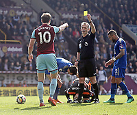 Burnley's Ashley Barnes is shown a yellow card by Referee Martin Atkinson for his challenge on Leicester City's Kasper Schmeichel (grounded)<br /> <br /> Photographer Rich Linley/CameraSport<br /> <br /> The Premier League - Burnley v Leicester City - Saturday 14th April 2018 - Turf Moor - Burnley<br /> <br /> World Copyright &copy; 2018 CameraSport. All rights reserved. 43 Linden Ave. Countesthorpe. Leicester. England. LE8 5PG - Tel: +44 (0) 116 277 4147 - admin@camerasport.com - www.camerasport.com