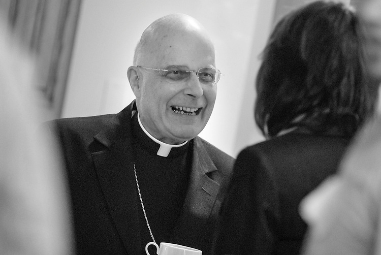 FILE PHOTOS: Francis Cardinal George, O.M.I., Archbishop of Chicago, visits with DePaul University students in April 2008 after celebrating Mass with them at the St. Vincent de Paul Parish. The group gathered at University House in Lincoln Park. (Photo by David Kamba)