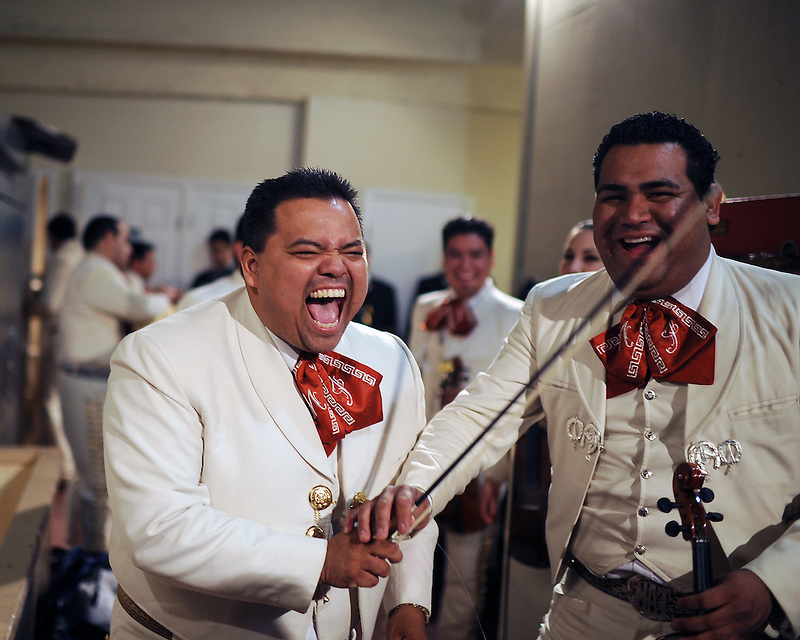 Mariachi Imperial de Mexico members Daniel Gonzales, left, and Misael Torbio laugh back stage before a grand finale with other bands during the 2012 Mariachi Festival at the Fox Theatre in Salinas, Calif.