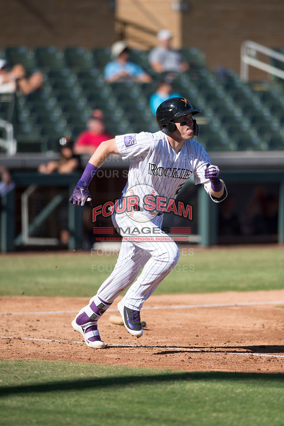 Salt River Rafters third baseman Tyler Nevin (2), of the Colorado Rockies organization, runs to first base during an Arizona Fall League game against the Glendale Desert Dogs at Salt River Fields at Talking Stick on October 31, 2018 in Scottsdale, Arizona. Glendale defeated Salt River 12-6 in extra innings. (Zachary Lucy/Four Seam Images)