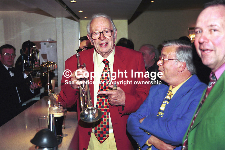 British jazz personality Humphrey Lyttelton with fellow band members at the bar of the Culloden Hotel during the 1999 Holywood International Jazz Festival, Holywood, Co Down, N. Ireland. Ref: 199906002..Copyright Image from Victor Patterson, 54 Dorchester Park, Belfast, UK, BT9 6RJ..Tel: +44 28 9066 1296.Mob: +44 7802 353836.Voicemail +44 20 8816 7153.Skype: victorpattersonbelfast.Email: victorpatterson@mac.com.Email: victorpatterson@ireland.com (back-up)..IMPORTANT: If you wish to use this image or any other of my images please go to www.victorpatterson.com and click on the Terms & Conditions. Then contact me by email or phone with the reference number(s) of the image(s) concerned.