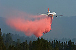 Greeley Hill, California-- July 31, 2008-Telegraph Fire-Wildfires Threaten Yosemite National Park. DC 10 lines up to pretreat with retardant near Bull Creek road on division M. ..Photo by Al GOLUB/Golub Photography