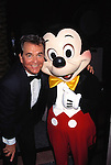 Dick Clark with Mickey Mouse.Attending the Academy of Television, Arts and Sciences Hall of Fame Inductions at Walt Disney World in Orlando, Florida..October 5, 1996.