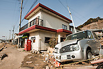Mar. 13, 2011 - Kita-Ibaraki, Japan - A car is shown piled up next to a destroyed office building two days after the 8.9 magnitude earthquake struck followed by a tsunami that hit the north-eastern region. The death toll is currently unknown with casualties that may run well into the thousands.