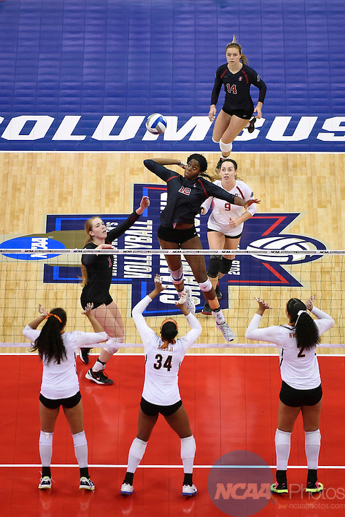 COLUMBUS, OH - DECEMBER 17:  Inky Ajanaku (12) of Stanford University jump for a spike against the University of Texas during the Division I Women's Volleyball Championship held at Nationwide Arena on December 17, 2016 in Columbus, Ohio.  Stanford defeated Texas 3-1 to win the national title. (Photo by Jamie Schwaberow/NCAA Photos via Getty Images)