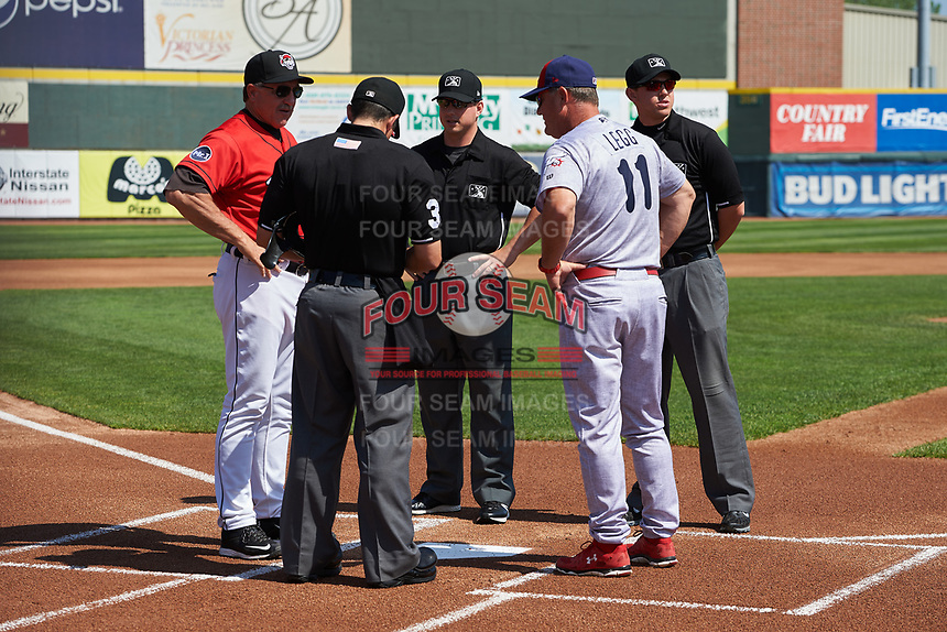Reading Fightin Phils manager Greg Legg (11) meets with Erie SeaWolves manager Lance Parrish and the umpiring crew before a game against the Erie SeaWolves on May 18, 2017 at UPMC Park in Erie, Pennsylvania.  Reading defeated Erie 8-3.  (Mike Janes/Four Seam Images)
