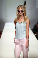 HOUSTON, TX - NOVEMBER 13 : Model walks the runway during a Fotini show on day two of Fashion Houston Spring 2013 Presented By Audi at the Wortham Theatre Center on November 13, 2012 in Houston, Texas. (Photo by Louis Dollagaray/MediaPunch inc) /NortePhoto