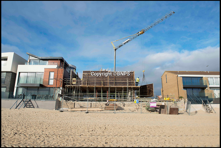 BNPS.co.uk (01202 558833)Pic: LeeMcLean/BNPS<br /> <br /> The development of the luxurious home on Sandbanks (pictured on the right of the construction).<br /> <br /> The new owners of a luxury home on Sandbanks will have to pass an interview with their multi-millionaire neighbour before they can buy it. <br /> <br /> Businessman Ashley Faull is building two seafront homes on one large plot on the exclusive Dorset peninsula; one for him and his wife and the other which he intends to sell for £4m.<br /> <br /> But just meeting the hefty asking price won't be enough for prospective buyers as Mr Faull, 51, insists on holding informal interviews with them to make sure the couple will get along with their new neighbours.<br /> <br /> And he said he is even prepared to sell the brand new three bedroom property called 'Sunshine' for less than the asking price if it means finding the right buyer.
