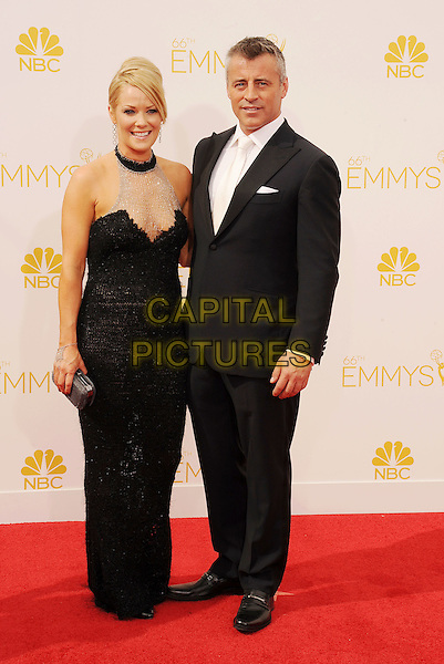 LOS ANGELES, CA- AUGUST 25: Actor Matt LeBlanc (R) and Andrea Anders arrive at the 66th Annual Primetime Emmy Awards at Nokia Theatre L.A. Live on August 25, 2014 in Los Angeles, California.<br /> CAP/ROT/TM<br /> &copy;Tony Michaels/Roth Stock/Capital Pictures