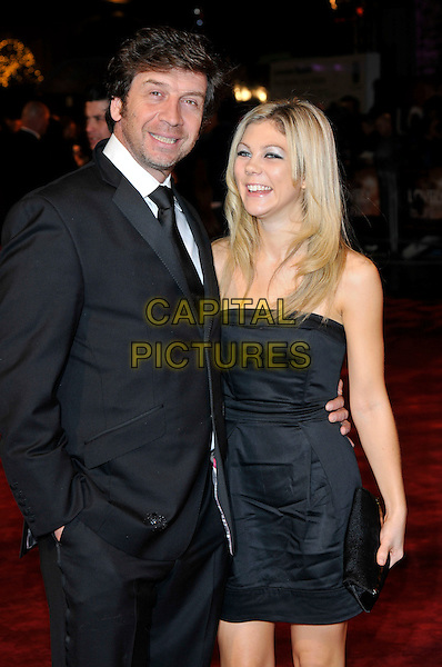 NICK KNOWLES & GUEST.The Royal Film premiere of 'The Lovely Bones' at the Odeon, Leicester Square, London, England..November 24th 2009.half length black strapless dress suit tie clutch bag hand in pocket .CAP/PL.©Phil Loftus/Capital Pictures.