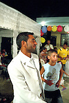 Ganti, dressed in white, is 17 year-old and will soon be married. He is dancing with his family members. Elbasan, Albania.