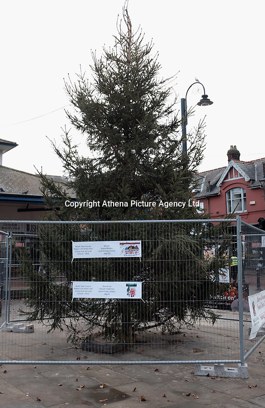 """Pictured: The Christmas tree in Neath, south Wales, UK. Saturday 03 December 2016<br /> Re: Residents are making their own decorations for Neath's Christmas tree this year after complaints about the town's festive decorations.<br /> Neath resident Darren Bromham-Nichols is calling on others to create their own decorations for the tree near the town centre, which has been described as """"bare with lots of dead wood."""", although the town council has said it has received no complaints.<br /> He hopes this will make Neath Town Council, who have funded the Christmas decorations for the town, take notice and help to decorate the tree."""