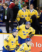 Par Marts (Sweden - Head Coach), Carl Klingberg (Sweden - 17), Jakob Silfverberg (Sweden - 13), Jacob Josefson (Sweden - 10), Tim Erixon (Sweden - 4), Marcus Johansson (Sweden - 11) - Team Sweden celebrates after defeating Team Switzerland 11-4 to win the bronze medal in the 2010 World Juniors tournament on Tuesday, January 5, 2010, at the Credit Union Centre in Saskatoon, Saskatchewan.