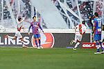 Rayo Vallecano´s Alberto Bueno celebrates a goal and Levante UD´s Antonio Garcia Aranda despair during 2014-15 La Liga match between Rayo Vallecano and Levante UD at Vallecas stadium in Madrid, Spain. February 28, 2015. (ALTERPHOTOS/Luis Fernandez)