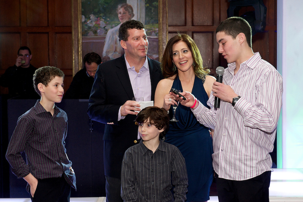 Bar Mitzvah boy being toasted by his older brother.