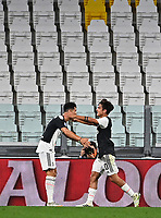Calcio, Serie A: Juventus - Lazio, Allianz Stadium, July 20, 2020.<br /> Juventus' Cristiano Ronaldo (l) celebrates after scoring his second goal with his teammate Paulo Dybala (r) during the Italian Serie A football match between Juventus and Lazio at the Allianz stadium in Turin, July 20, 2020.<br /> UPDATE IMAGES PRESS/Isabella Bonotto
