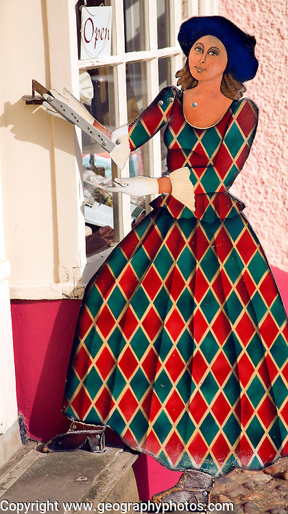 Cut out model of woman in old fashioned clothing outside shop, Woodbridge, Suffolk, England