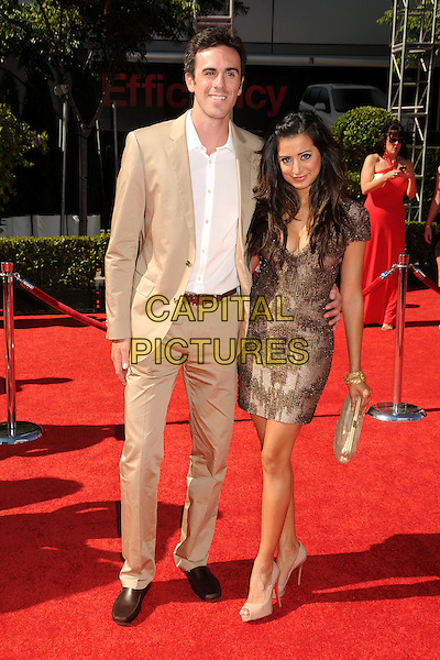 RYAN MILLER & NOUREEN DeWULF.18th Annual ESPY Awards - Arrivals held at Nokia Theatre L.A. Live, Los Angeles, California, USA..July 14th, 2010.espys full length dress beige suit white shirt brown bronze sequins sequined arm around waist couple gold clutch bag .CAP/ADM/BP.©Byron Purvis/AdMedia/Capital Pictures.