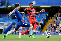 Cesc Fabregas of Chelsea and Huddersfield Town's Rajiv Van La Parra challenge for the ball during Chelsea vs Huddersfield Town, Premier League Football at Stamford Bridge on 9th May 2018