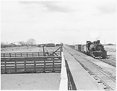 D&amp;RGW #497 with southbound freight passing Hooper stockyards.<br /> D&amp;RGW  Hooper, CO  Taken by Richardson, Robert W. - 1950