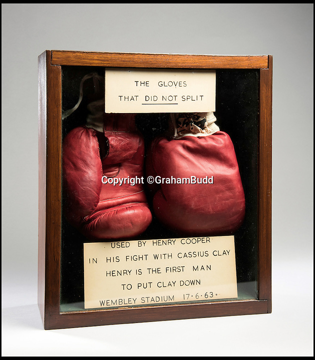 BNPS.co.uk (01202 558833)<br /> Pic: GrahamBudd/BNPS<br /> <br /> For sale...'Enry's 'Ammer's that floored The Greatest.<br /> <br /> A British boxing legend's gloves - that Muhammad Ali claimed hit him so hard &quot;his ancestors in Africa felt it&quot; have emerged for auction for the knock out price of &pound;50,000. <br /> <br /> Sir Henry Cooper wore them when he sent him crashing to the mat with his trademark 'Enry's 'Ammer' left hook in front of a baying Wembley crowd in 1963.<br /> <br /> Described at the time as 'the punch that shook the world' it was one of the few times the fighter was floored - although he controversially recovered.