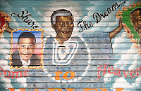 "A mural on a security gate in Harlem in New York on a rainy Friday, December 6, 2013 shows a memorial to the late Nelson Mandela. The painting by ""Franco the Great"" also shows Pres. Barack Obama and other black personalities. The South African civil rights activist passed away at the age of 95. Mandela visited Harlem in 1990 on his first visit to New York. (© Richard B. Levine)"