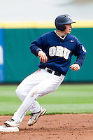 Cam Schiller (9) of the Oral Roberts Golden Eagles watches a teammate reach first base while standing on second base during a game against the Missouri State Bears on March 27, 2011 at Hammons Field in Springfield, Missouri.  Photo By David Welker/Four Seam Images