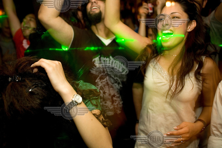 People dance at a gig by the popular DJs Bass Foundation at a small club in South Extension, New Delhi.
