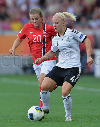 17.07.2013. Kalmar, Sweden.  Leonie Maier (r) of Germany challenges for the ball with Emilie Bosshard Haavi of Norway during the UEFA Women's EURO 2013 Group B soccer match between Germany and Norway at the Kalmar Arena in Kalmar, Sweden, 17 July 2013.