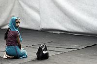 Roma, 19 Agosto 2012.Piazza Vittorio.La comunità islamica celebra la fine del mese di digiuno con la festa Eid al-fitr..Una ragazza nella parte riservata alle donne.Muslim immigrants in Piazza Vittorio square, in Rome's Esquilino multi-ethnic quarter, for the Eid al-Fitr prayer to mark the end of the fasting month of Ramadan