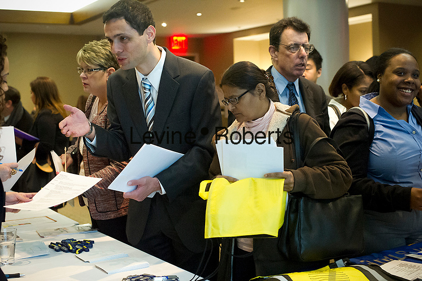 Job seekers attend a job fair at midtown in New York on Thursday, October 18, 2012.  The US Labor Department reports new claims for unemployment benefits for last week were a seasonally adjusted 388,000. ( © Frances M. Roberts)