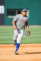 Ray Olmedo (13) of the Durham Bulls takes some ground balls at third base prior to the game against the Charlotte Knights at BB&T Ballpark on April 24, 2014 in Charlotte, North Carolina.  The Knights defeated the Bulls 4-3.  (Brian Westerholt/Four Seam Images)