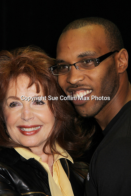Days Suzanne Rogers with Mr. Romance Contestant Delon at Romantic Times Booklovers Annual Convention 2011 - The Book Industry Event of the Year - April 9, 2011 at the Westin Bonaventure, Los Angeles, California for readers, authors, booksellers, publishers, editors, agents and tomorrow's novelists - the aspiring writers. (Photo by Sue Coflin/Max Photos)