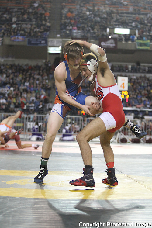 Ridgefield's Trevor Newburn, left, struggles to get away from Steilacom's Jacobi Blankenship during their 126 pound match on Friday, Feb, 19, 2016 at the Mat Classic XXVIII held in the Tacoma Dome. Newburn went onto win his match 7-5.  (Jim Bryant Photo)