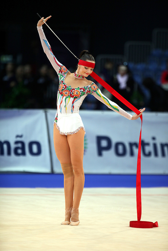 Anna Bessonova of Ukraine begins ribbon routine at 2009 World Cup at Portimao, Portugal on April 18, 2009.  (Photo by Tom Theobald).