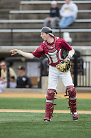 Harvard Crimson catcher Josh Ellis (9) on defense against the Wake Forest Demon Deacons at David F. Couch Ballpark on March 5, 2016 in Winston-Salem, North Carolina.  The Crimson defeated the Demon Deacons 6-3.  (Brian Westerholt/Four Seam Images)