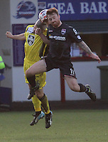 Jim Goodwin (left) challenges Craig Curran in the air in the Ross County v St Mirren Scottish Professional Football League match played at the Global Energy Stadium, Dingwall on 17.1.15.